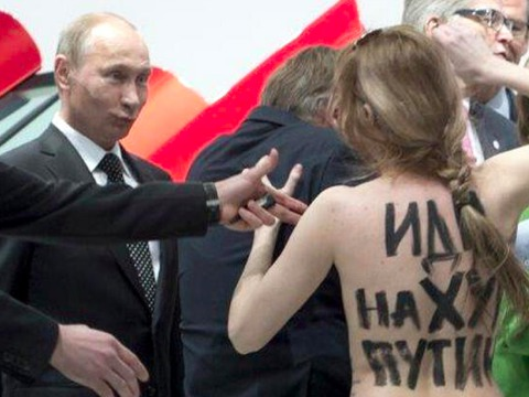Vladimir putin makes the best possible face after he and merkel are confronted by topless protesters web